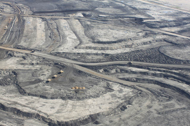 Trucks in an open pit mine in Canada's oil sands. Photo by Kathleen Black/Flickr.