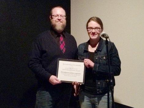 Board member, Craig McNaughton, and Coordinator, Jessie Best, accepting the SEN Environmental Activism Award, on behalf of the Saskatoon CarShare Co-operative