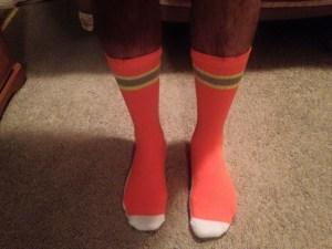 Louis models his SAR orange socks.