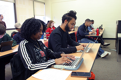 Students coding on their computers