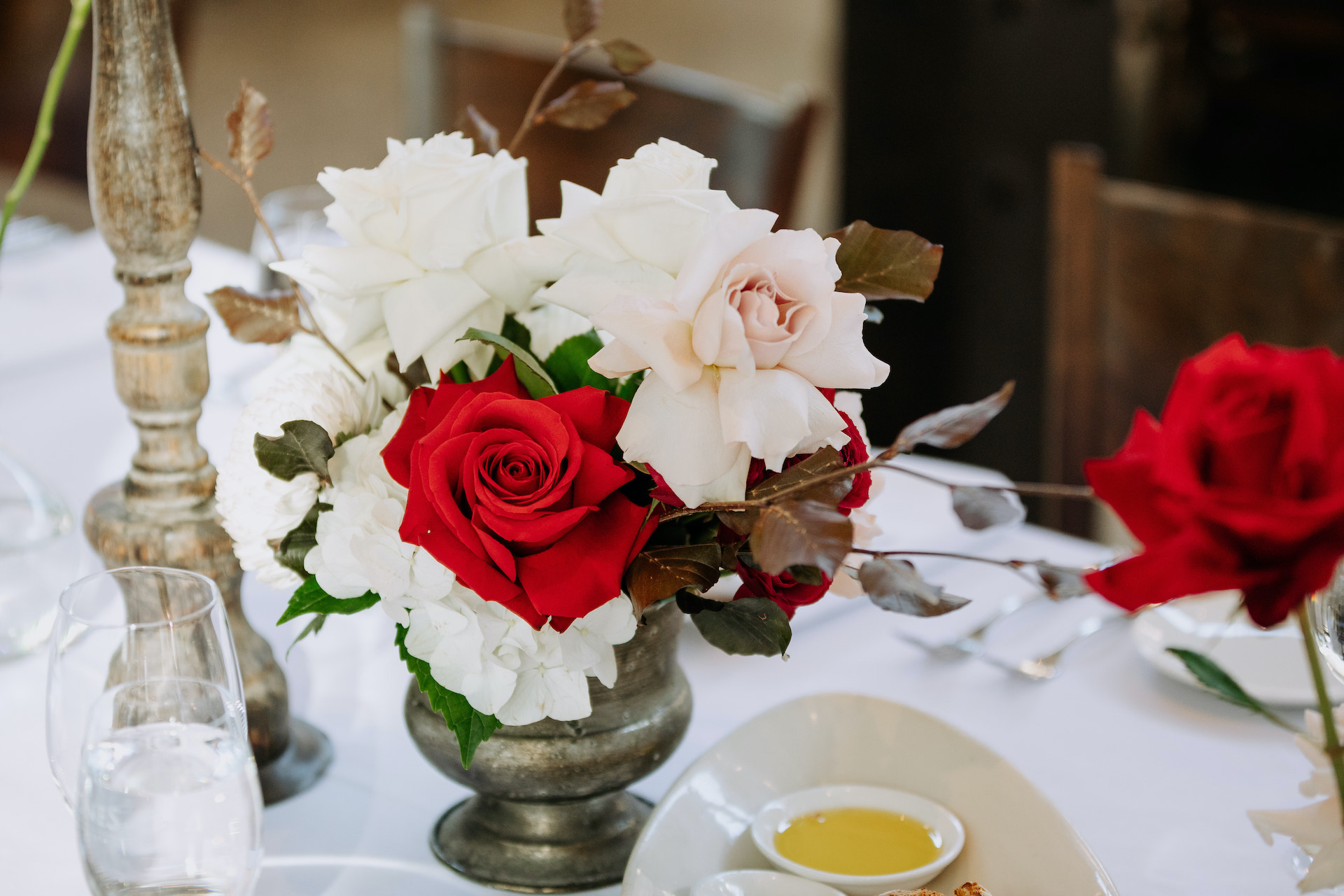 No floral foam wedding tablescape styling with bright wedding flowers at Stones of the Yarra Valley