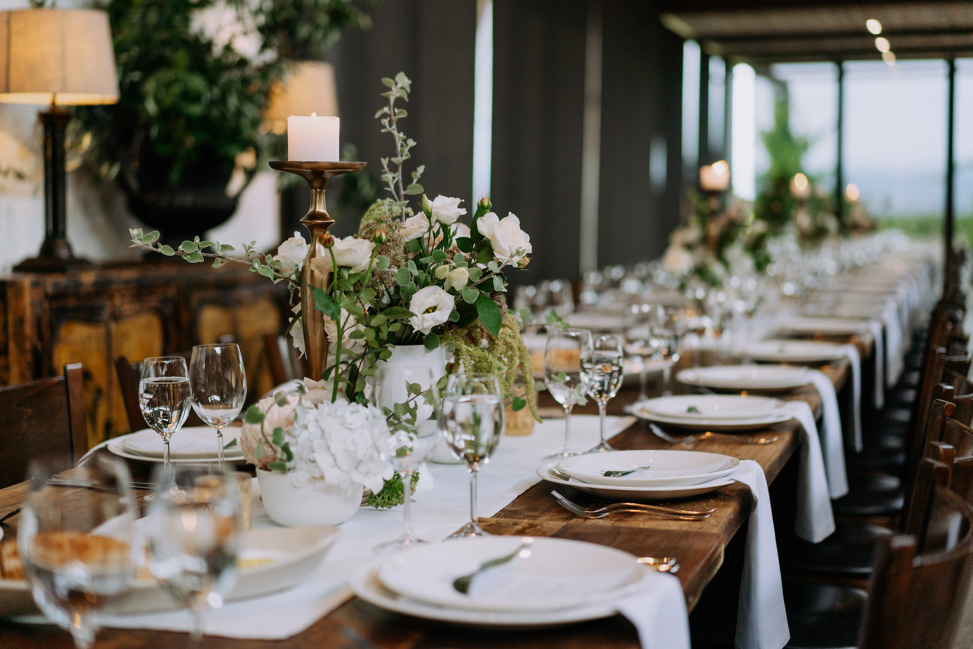 White and green wedding flowers and summer wedding reception tablescape styling at Stones of the Yarra Valley.