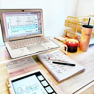 laptop pink stand in girly office desk