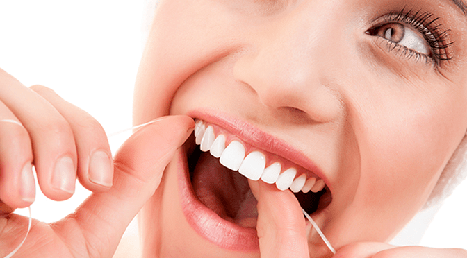 dental woman flossing great teeth