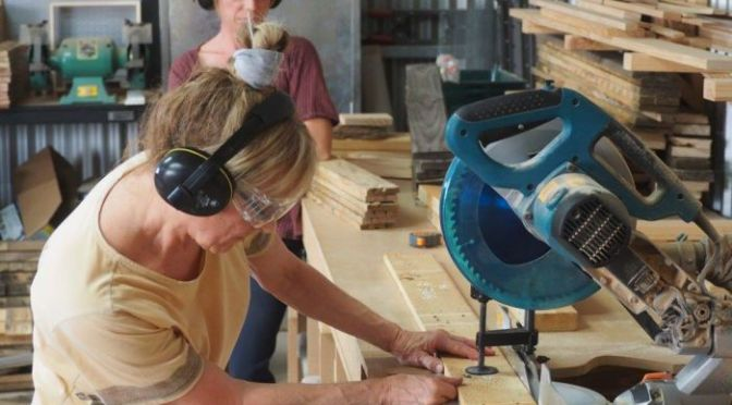 woman with miter saw