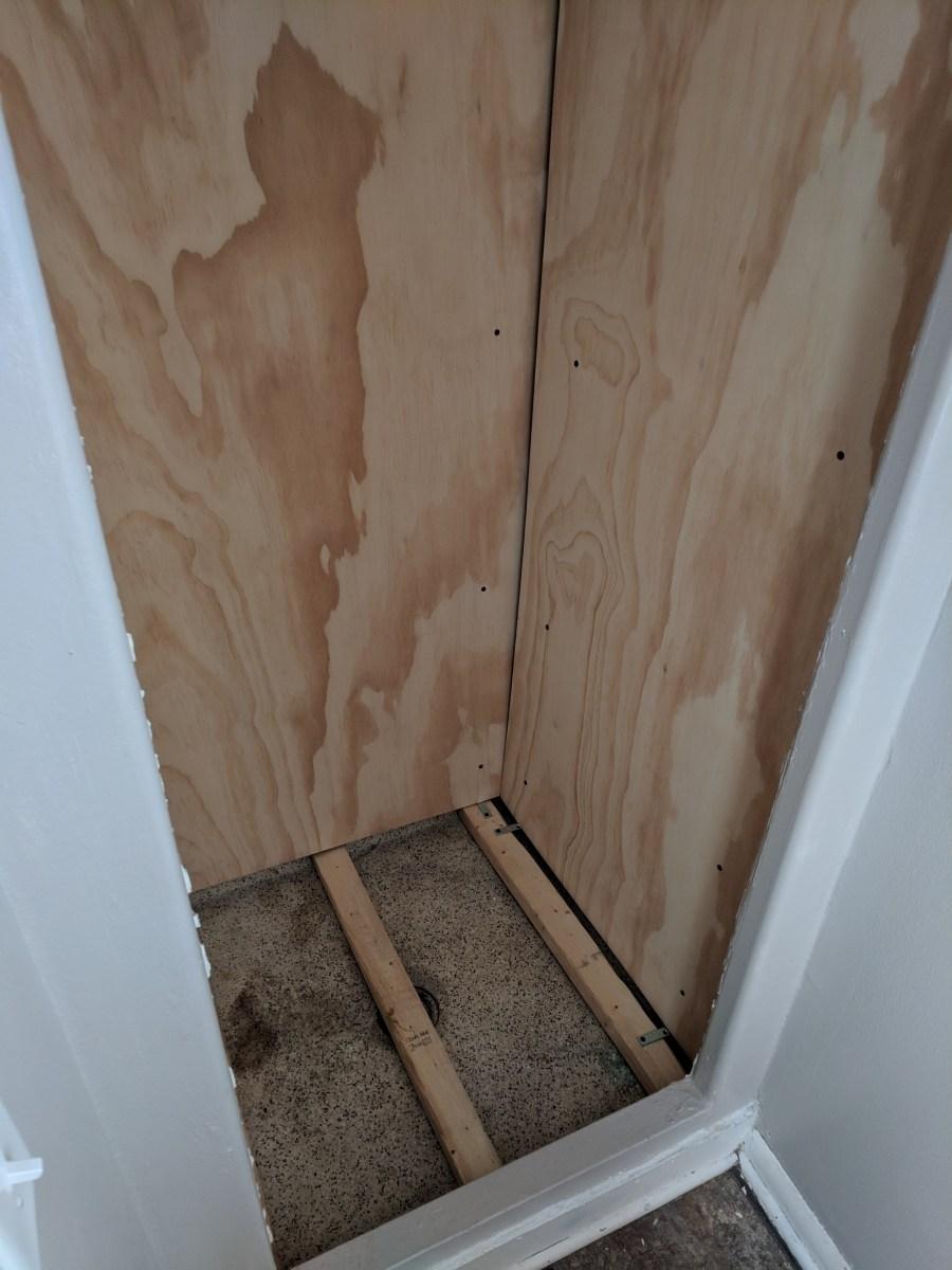 Bathroom closet plywood wall floor
