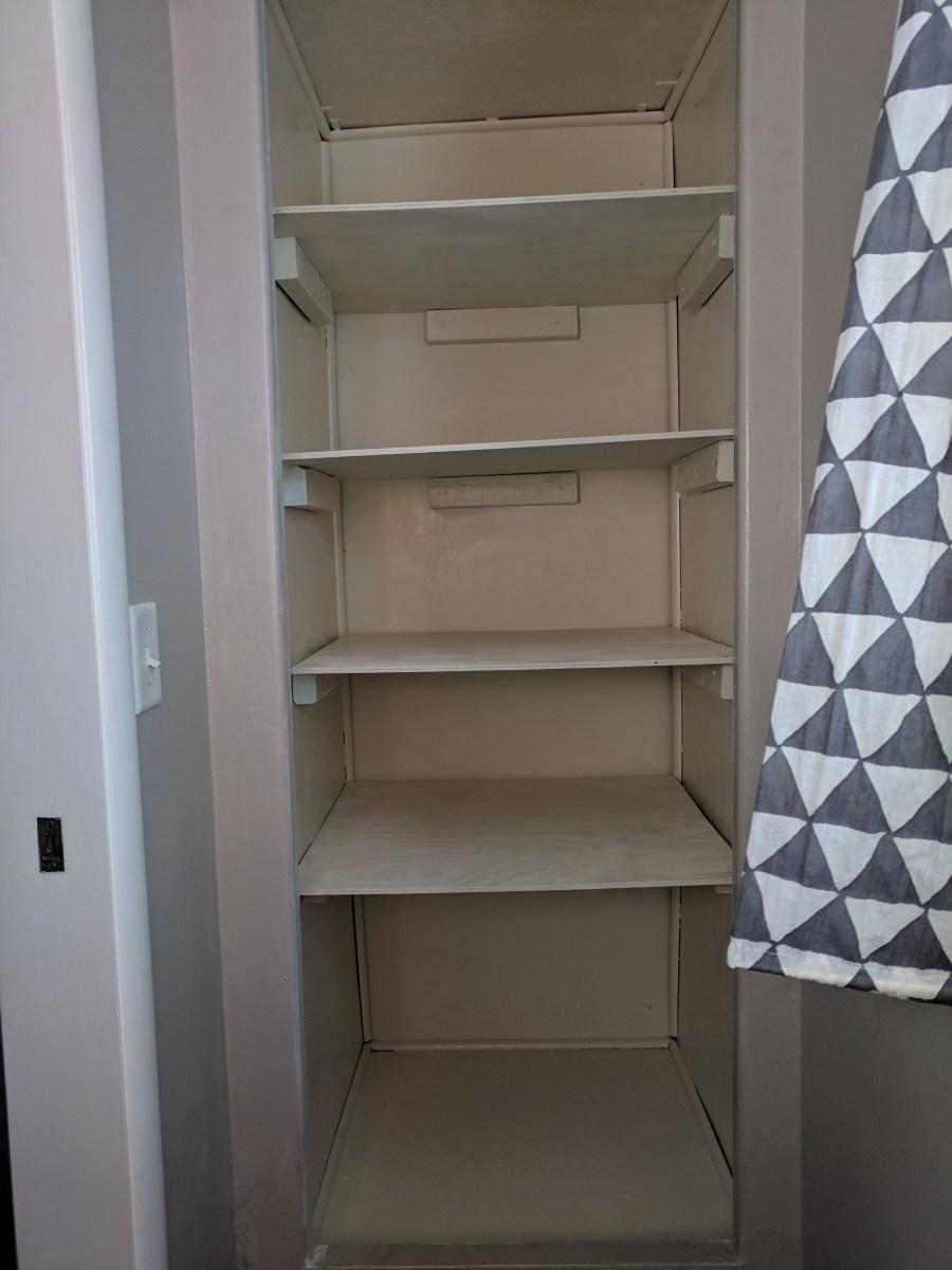 Bathroom closet shelves installed
