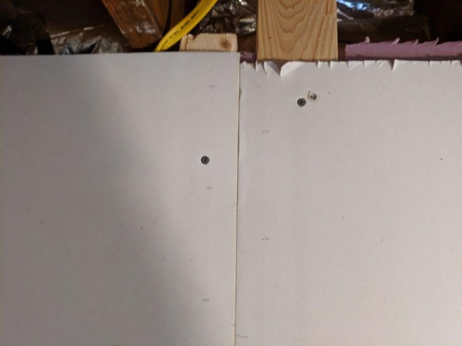 Basement drywall panel securing