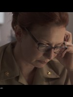 Jennie Olson Six plays 'Lt. Commander Byrne' trying to ignore the Marines.