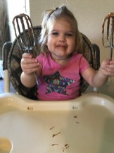 Anna eating the Pumpkin Pie Muffin Top batter.