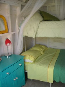 Double bunk beds are comfy and cozy.