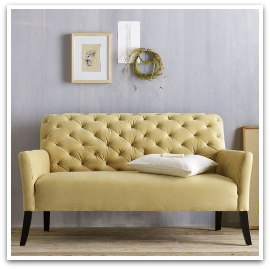 Tufted yellow settee from West Elm