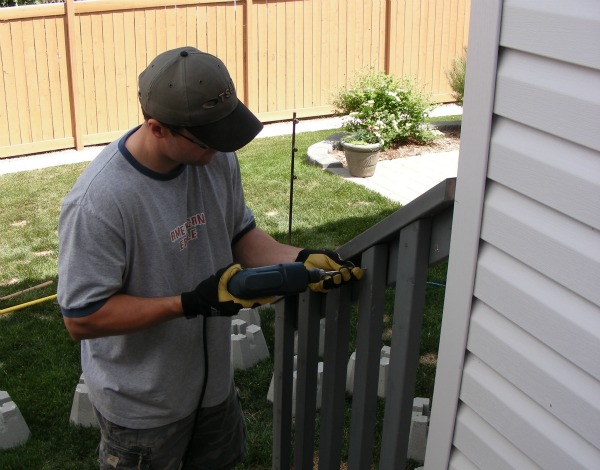 Getting Rid of the Orange Stained Fence - BEFORE