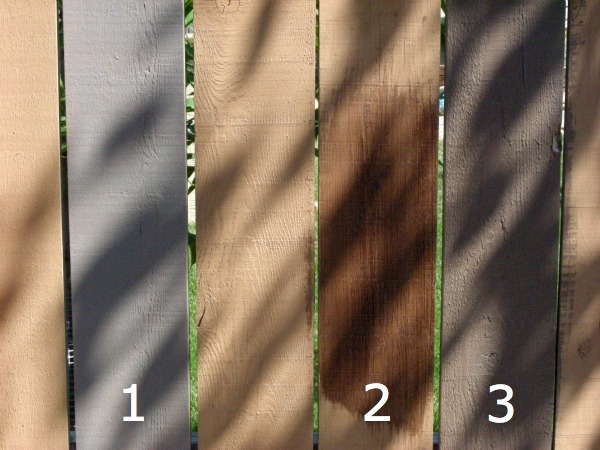 Comparing Behr Tugboat and Boot Hill Grey Stain Colors to Wood Chip on Fence