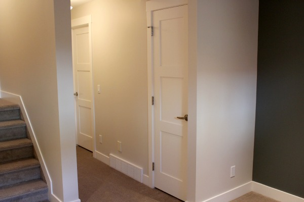 Ideas for Finishing a Basement - Basement Closet Addition with White Painted Shaker Style Door