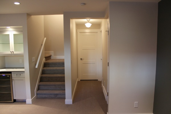 Finishing the Basement - Hallway with Schoolhouse Light Fixture and Shaker Style Trim