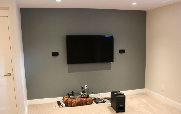 Basement Renovation Ideas - Basement Family Room with Built-in Speaker System and Wall-mounted Flatscreen TV