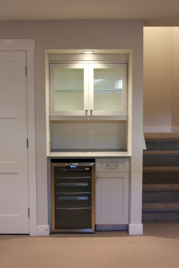 Basement Snack Bar with Stainless Steel Beverage Fridge - Utilizing the Space Under the Stairs