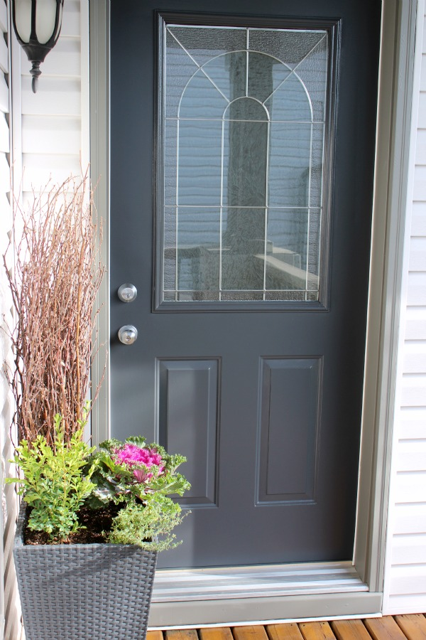 Front Door Painted in Benjamin Moore Wrought Iron 2121-10 with Light Grey Siding