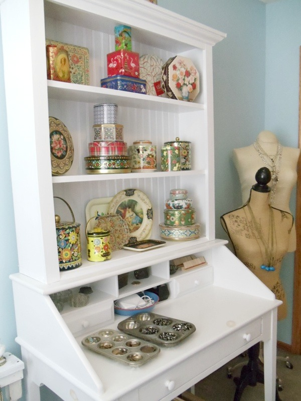 Workspaces That Inspire - Renee's vintage tin collection in white painted hutch