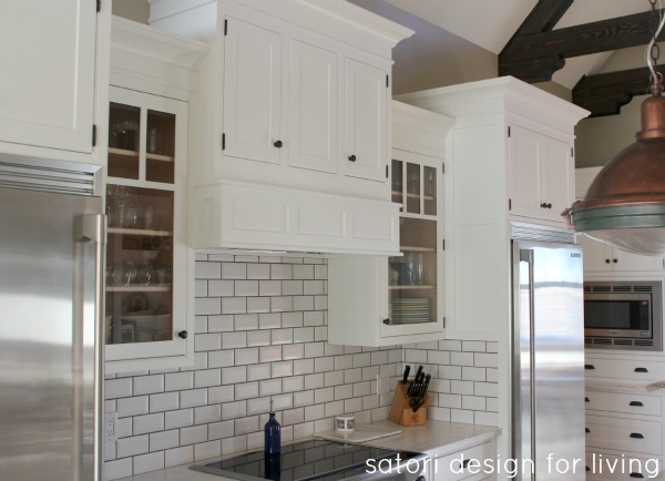 Classic Kitchen with White Painted Cabinets, Subway Tile Backsplash and Copper Pendants