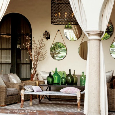 Collection of mirrors in an outdoor space via Style at Home | Design by Lara McGraw | Photo by Donna Griffith