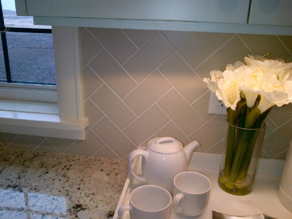 Showhome Tour - Grey Herringbone Subway Tile Backsplash Kitchen