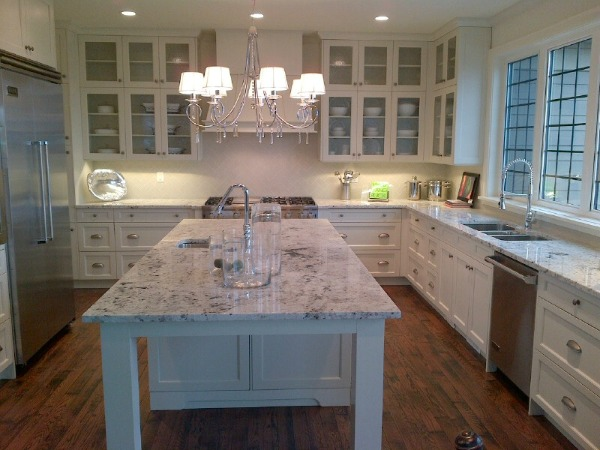 Showhome Tour - Marble and White Kitchen with Chandelier Over Island