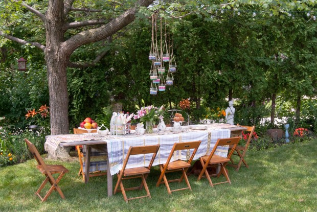 Side Garden Table with Hanging Lanterns - Photo by Adrienne DeRosa