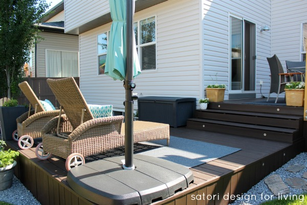 Backyard Updates - Behr Cordovan Brown Solid Stained Deck with Wicker Lounge Chairs - Satori Design for Living