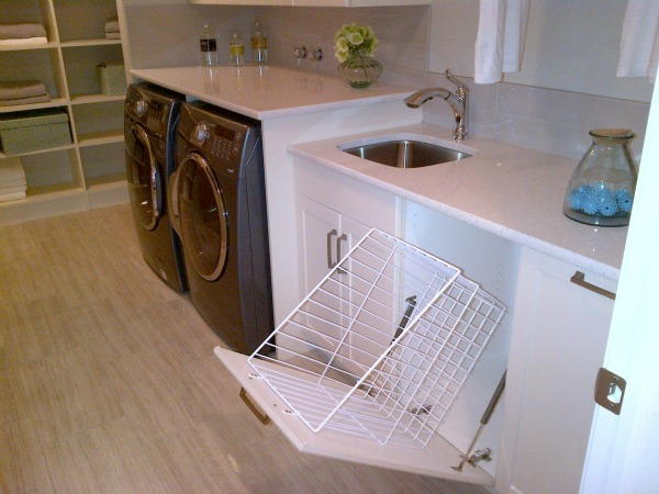 Functional Laundry Room with Pull-out Sorting Bins and Quartz Countertops