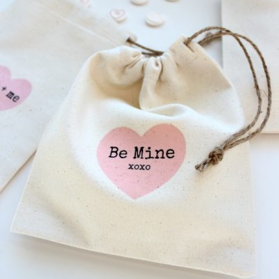 Surprise your loved ones with these DIY Valentine's Day treat bags. The iron-on transfer printables can be customized and are so fun!