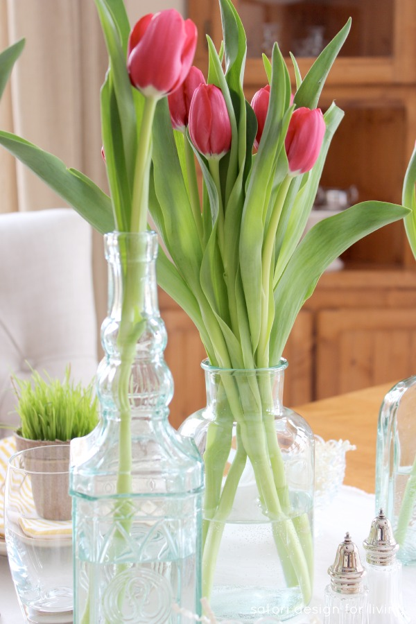 Easter Tablescape with Green Glass Bottles and Spring Tulips - Satori Design for Living