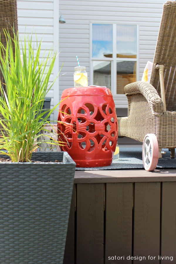 Outdoor Living Space with Ornamental Grass Planters and Red Ceramic Garden Stool - Satori Design for Living