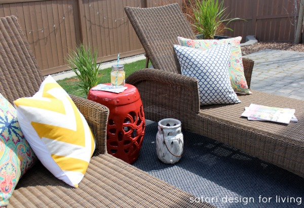 Outdoor Living Space with Wicker Lounge Chairs, Red Garden Stool and Yellow Chevron Pillow - Satori Design for Living