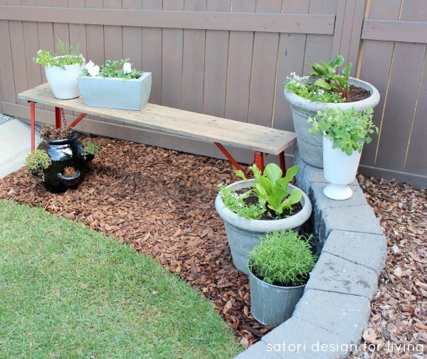 Salvaged Red Bench with a Vegetable, Herb and Flower Container Garden