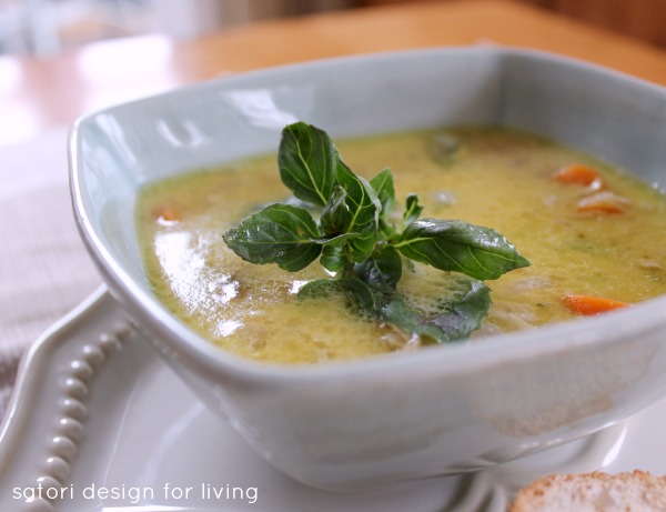 Coconut Curry Chicken Soup in Bowl with Basil Garnish