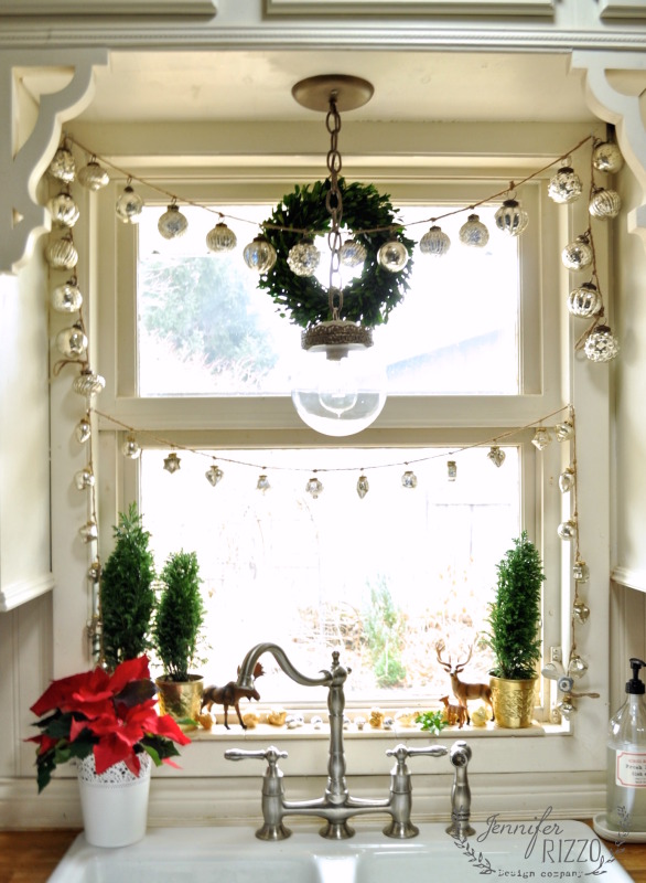 Christmas Inspiration - Window framed in mercury glass garlands - Jennifer Rizzo
