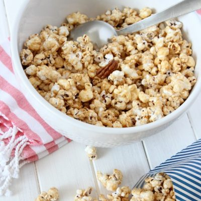 A caramel popcorn recipe made with honey, cinnamon, nutmeg and pecans. No corn syrup. Simple, delicious and perfect for parties! Get recipe at SatoriDesignforLiving.com