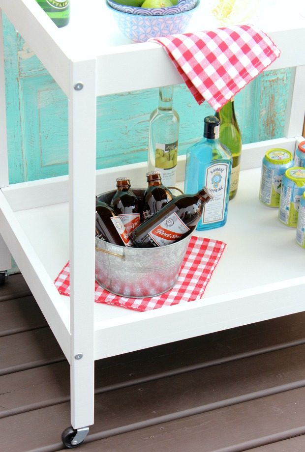 DIY Bar Cart for Outdoor Entertaining Stocked with Drinks and Supplies