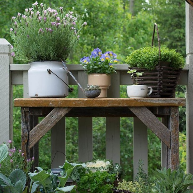 Decorating Outdoor Spaces - Barn Wood Garden Table with Potted Herbs and Flowers by Keeping with the TImes