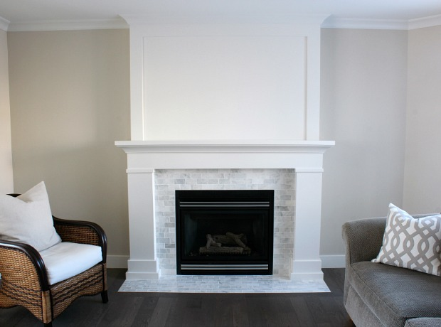 White Painted Fireplace with Marble Subway Tile Surround