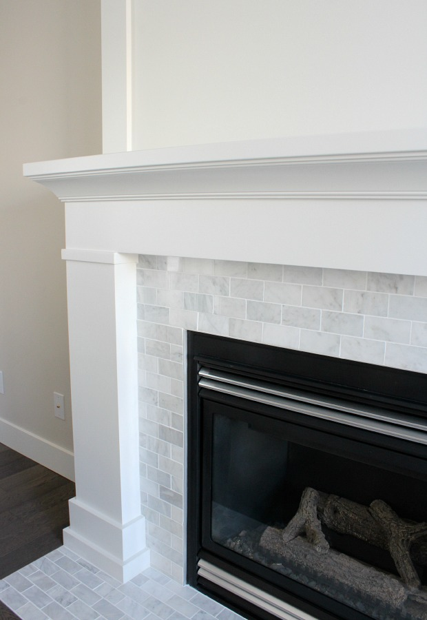 White Painted Fireplace with Marble Subway Tile