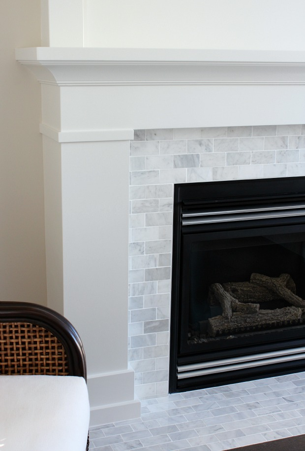 White Dove Painted Fireplace with Marble Subway Tile Surround