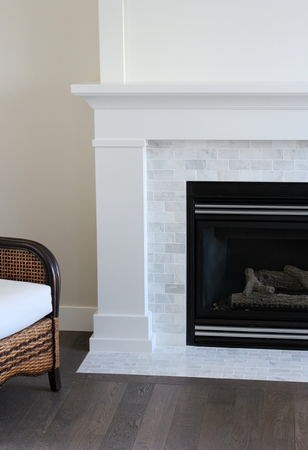 White and Marble Fireplace with White Painted Mantel and Marble Subway Tile Surround