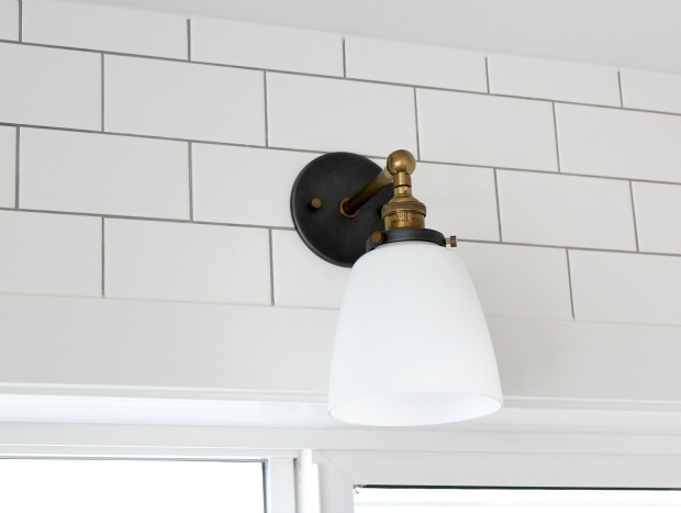 IKEA Kitchen Design Details - Aged Brass Sconce with Milk Glass Shade and White Subway Tile with Grey Grout Around the Kitchen Window