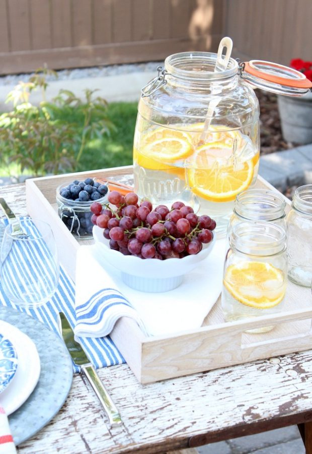 Flea Market Style Outdoor Table Setting - Oversized Jar with Orange Infused Water