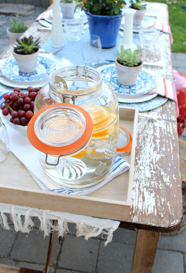 Outdoor Table Setting with Glass Canister and Wooden Tray
