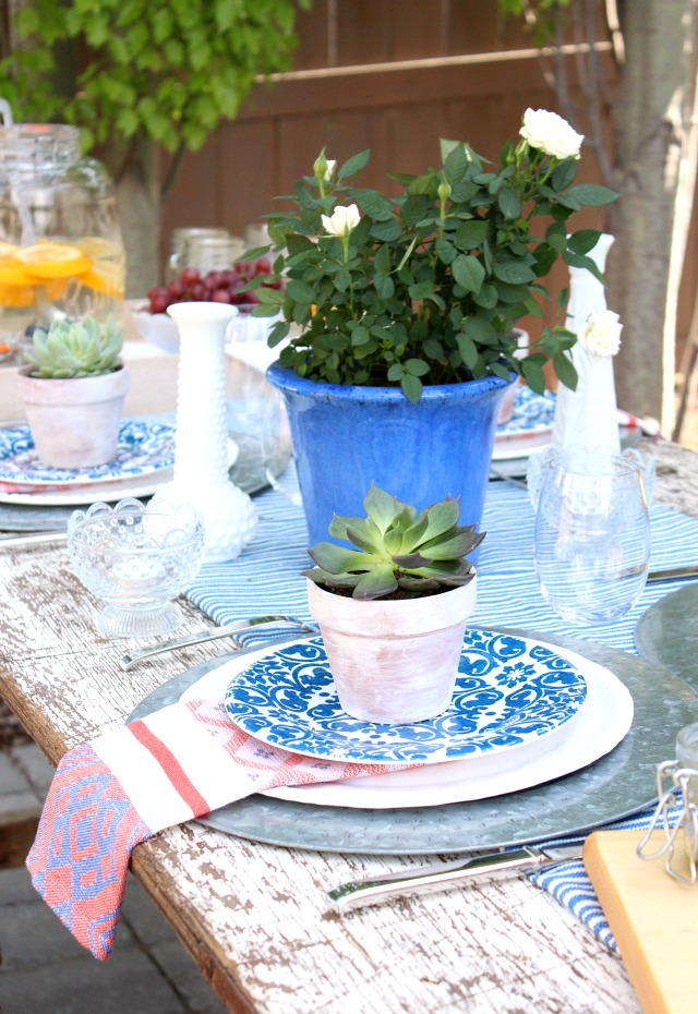Flea Market Style Outdoor Table Setting with Potted Succulents and Roses