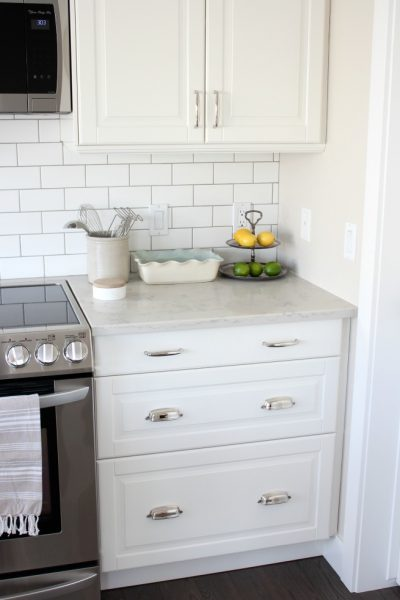 Ikea Kitchen Makeover - White Cabinets with White Subway Tile and Marble Quartz Countertops